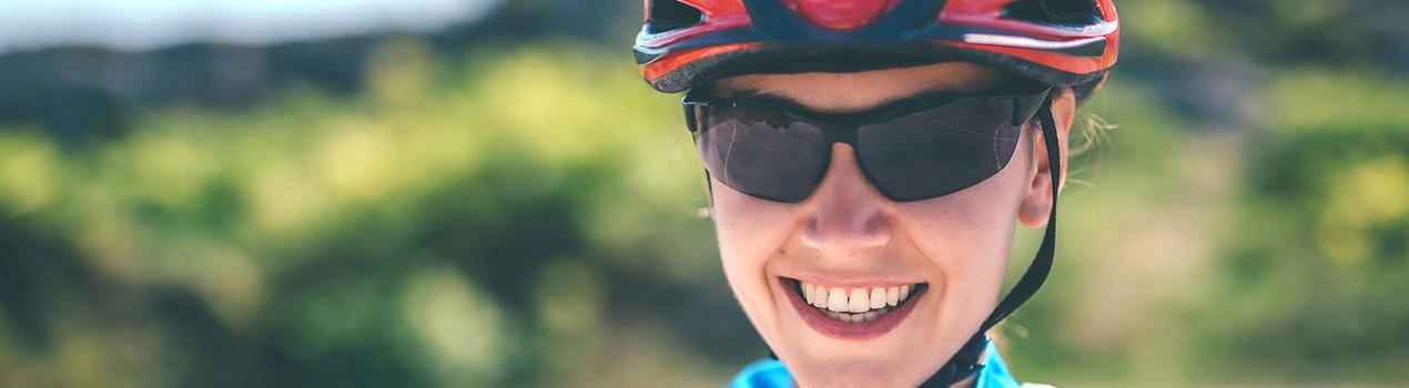 Woman wearing protective eyeglasses while biking